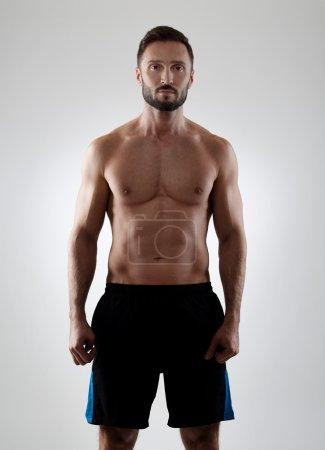 Muscular man on gray