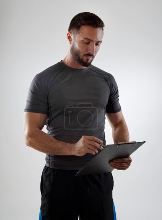 Instructor with clipboard