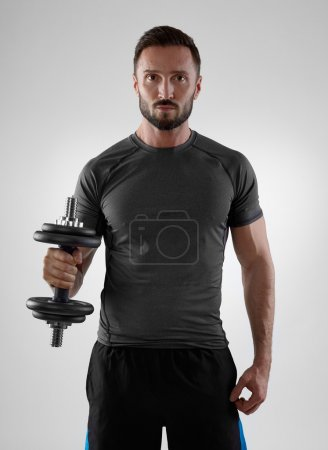 Photo for Muscular man with weights, isolated on gray - Royalty Free Image