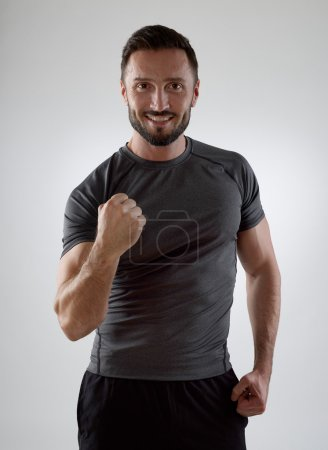 Photo for Happy sportsman looking at camera - Royalty Free Image