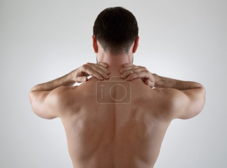 Photo for Sportsman with backache, gray background - Royalty Free Image