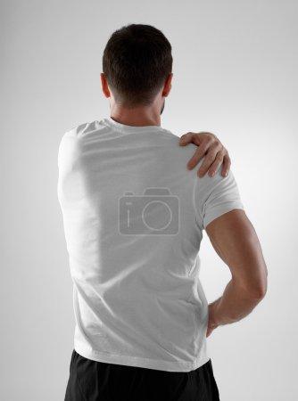 Shoulder pain, gray background