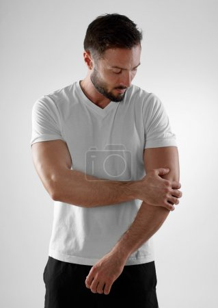 Elbow pain, gray background