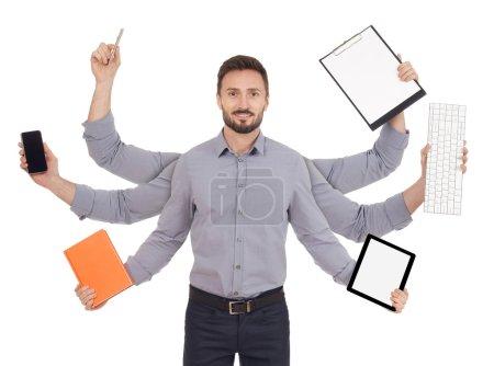 Photo pour Homme gai avec bureau fournit à six mains, fond blanc - image libre de droit