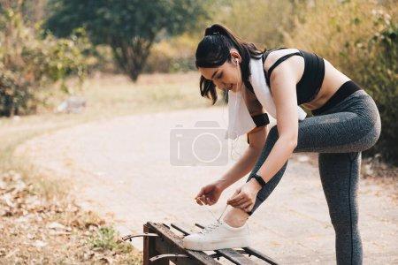 Portrait of beautiful asian young woman runner tyi...