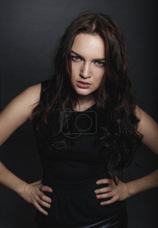 High fashion sensual girl in the black dress in the studio