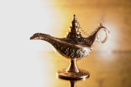Aladdin's lamp on bright background