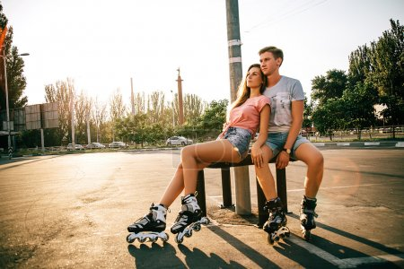 loving couple sitting at the street on the sunset