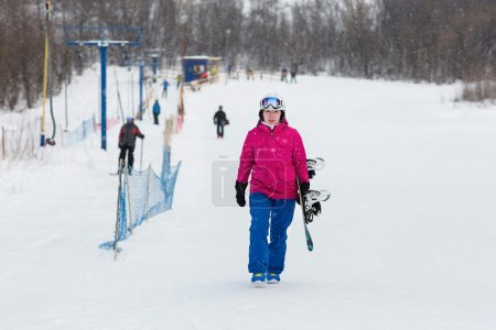 Woman snowboarder on the slopes frosty winter day