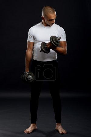 Sportsman doing training with dumbbells..