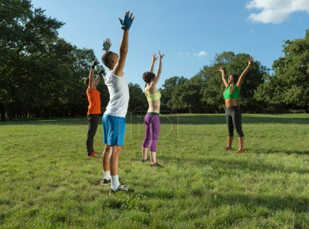 Group of people exercise . Outdoor Fitness.