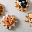 Homemade waffles with fruits on white vintage tabl...