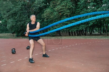man doing crossfit training outdoor