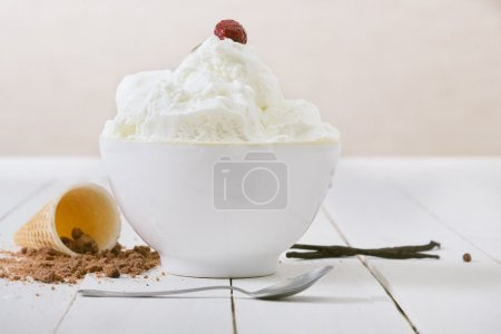 Photo for Vanilla Ice Cream on white wooden table. Selective focus and small depth of field. - Royalty Free Image