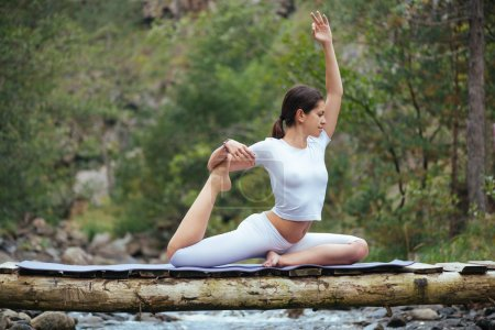 Woman  doing yoga in nature.