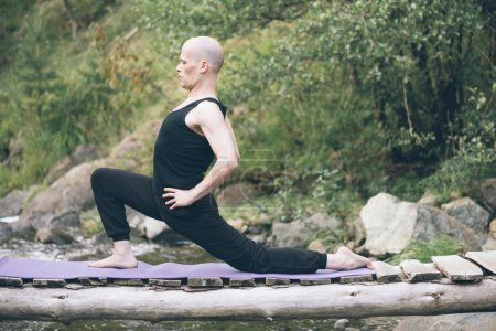 Man doing yoga in nature.