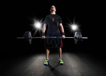 Photo for Crossfit athlete performs weight lift - Royalty Free Image