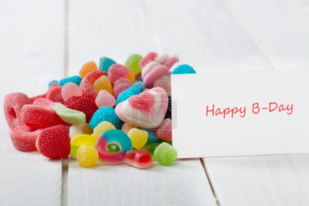 A lot of candies with greeting card.