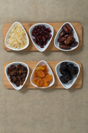 Dried fruit on the vintage table.