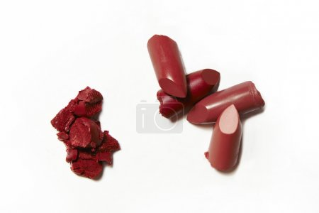 smudge and broken red lipsticks