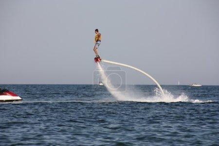 Man performing water flyboarding