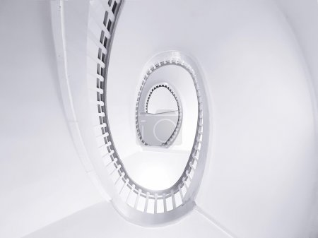 White oval spiral stairs