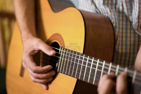 Photo for Man playing classical acoustic guitar - Royalty Free Image