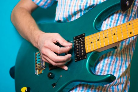 Photo for Hand with an electric guitar - Royalty Free Image