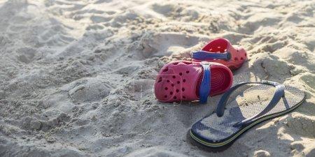 Plastic flip flops on the beach