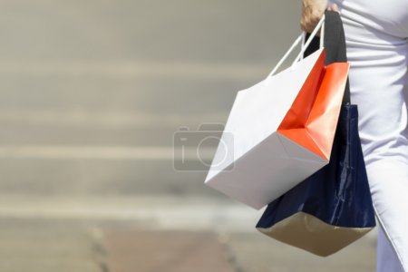 Photo for Happy girl shopping in the city, urban concepts - Royalty Free Image