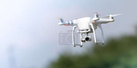 Photo for Flying drone in action; photographed on a defocused background. Royalty free image, no logos in the photo. - Royalty Free Image