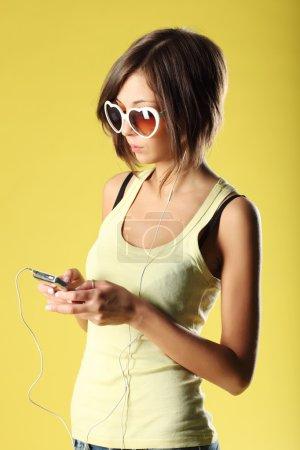 Beautiful girl on yellow background