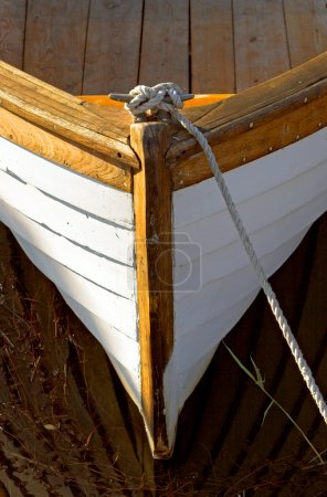 Bow and rope of small wooden boat...