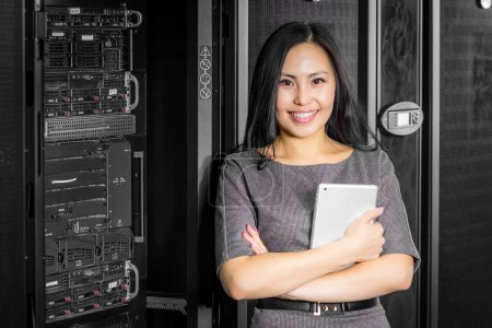 Engineer businesswoman in network server room