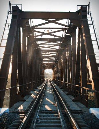 Old steel railway bridge on the river. Empty train bridge