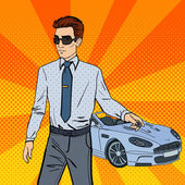 Successful Businessman Man Holding a Car Key Pop Art Vector illustration