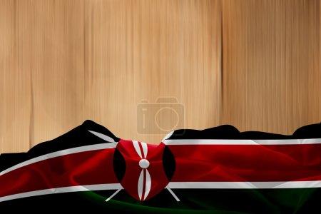 Kenya flag and wood background