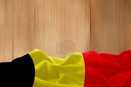 Belgium flag and wooden background