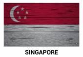 Singapore flag on wood texture background