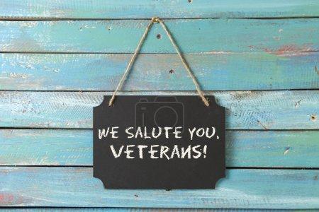Veterans day chalk sign on blue background