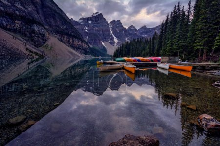 Colourful canoes on the clear lake