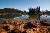 Clear lake, pine trees and mountains