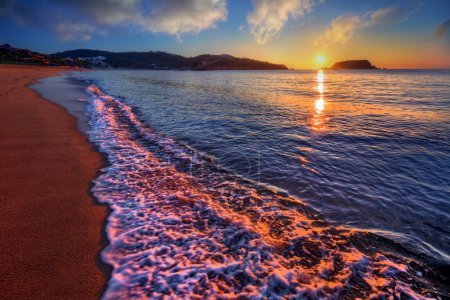 Trodden sand on an ocean beach