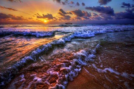 sunset over an ocean beach shore