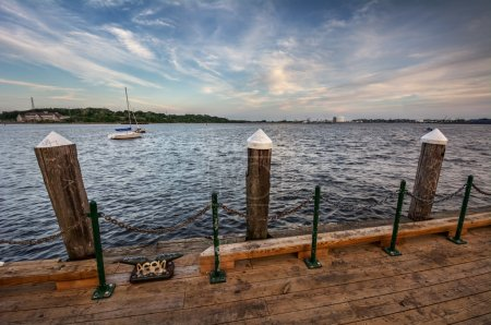 Wooden pier around the calm river