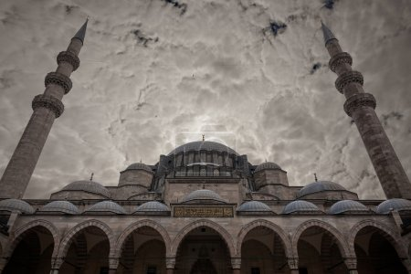 Blue mosque under cloudy sky