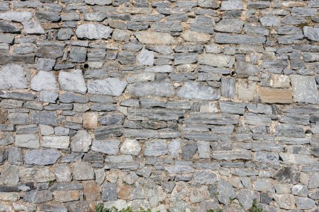 Stone wall from weathered variety gray stones