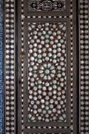 Doors with mother-of-pearl inlay