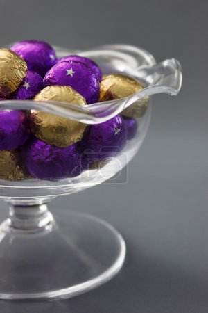 Photo for Glass bowl with candies in glossy wrapping - Royalty Free Image