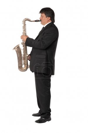 Mature musician man playing saxophone